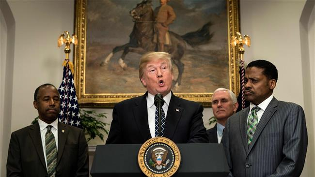 US President Donald Trump (C) speaks at the White House on January 12, 2018 in Washington, DC. (AFP photo)