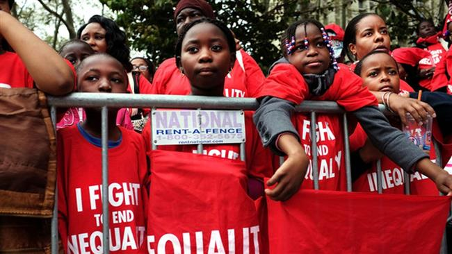 Thousands of students, parents and educators rally in Brooklyn demanding an end to separate and unequal schools in New York City on October 7, 2015. (Getty images)