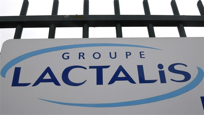 A picture taken on January 12, 2018 shows the logo at the entrance of the headquarters builing of French dairy group Lactalis in Laval, western France. (Photo by AFP)