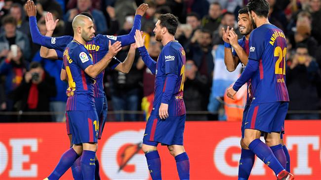 Barcelona's Argentinian forward Lionel Messi celebrates with Barcelona's Spanish defender Jordi Alba after scoring his second goal during the Spanish Copa del Rey round of 16 second leg football match FC Barcelona vs RC Celta de Vigo at the Camp Nou stadium in Barcelona on January 11, 2018. (AFP)