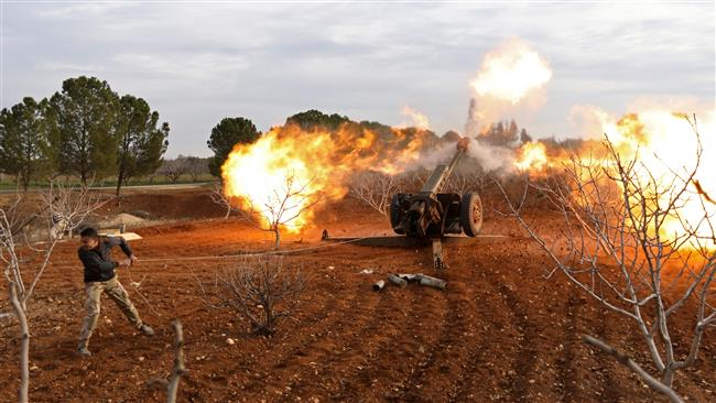 A Takfiri militant fires a missile from a village near al-Tabanah during ongoing battles with government forces in Syria's Idlib province on January 11, 2018. (Photo by AFP)