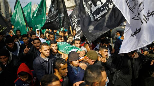 Palestinian mourners carry the body of Amir Abu Musaid, 16, during his funeral in the al-Maghazi refugee camp, located in in the center of the Gaza Strip, after he was shot dead in clashes with the Israeli military along the Gaza border the previous day, on January 12, 2018. (AFP)