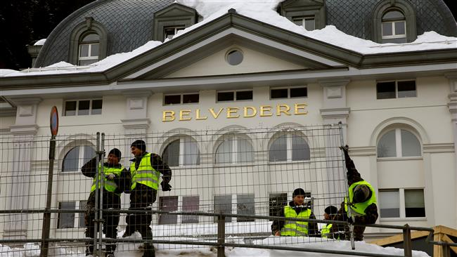 Swiss army forces set up protection fences for the upcoming World Economic Forum in front of Hotel Belvedere in the Swiss mountain town of Davos on January 11, 2018. (Reuters photo)