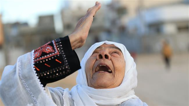 A Palestinian woman reacts on a street in Beit Hanun in the northern Gaza Strip on December 7, 2017, as people gather during a rally against US President Donald Trump's recognition of Jerusalem al-Quds as Israel's capital. (Photo by AFP)