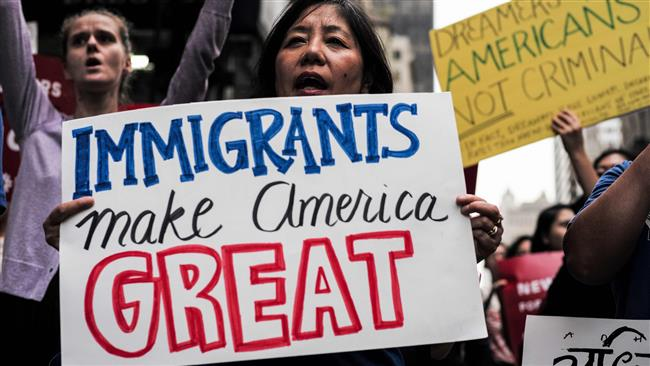 People protest against US President Donald Trump during a rally in support of the Deferred Action for Childhood Arrivals (DACA), near the Trump Tower in New York on October 05, 2017. (Photo by AFP)