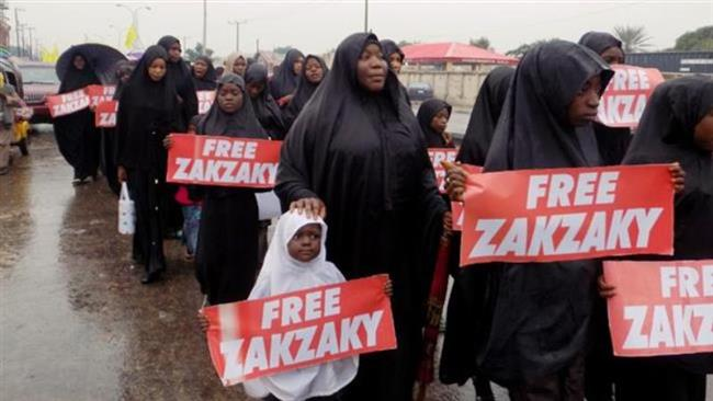 This file photo taken on August 11, 2016 in northern Nigerian city of Kano shows protesters from the Islamic Movement in Nigeria (IMN) marching in the rain through the streets to press for the release of their leader Ibrahim Zakzaky. (Photos by AFP)