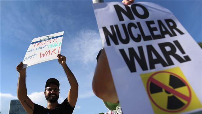 Protesters gather to ask US President Donald Trump to stop his drive to war against North Korea on August 14, 2017, in Miami, Florida. (Photo by AFP)