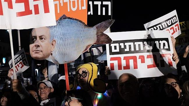 Israelis hold an anti-graft protest in Tel Aviv on January 13, 2018.