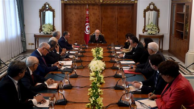 Tunisian President Beji Caid Essebsi (C) attends a meeting with representatives of political parties, unions, and employers on January 13, 2018 in the capital, Tunis. (Photo by AFP)