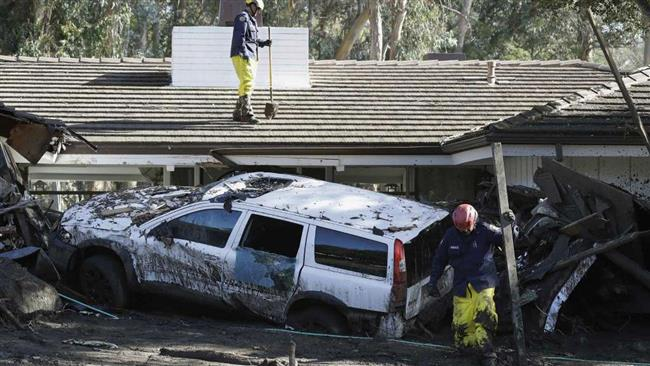 Emergency crew members search an area damaged by storms in Montecito, Calif., Friday, Jan. 12, 2018. (Photo by AP)