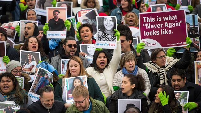 A rally in Washington last month in support of the Deferred Action for Childhood Arrivals program. (Photo via The New York Times)