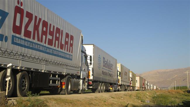 Turkish trucks cross the border into Iran.