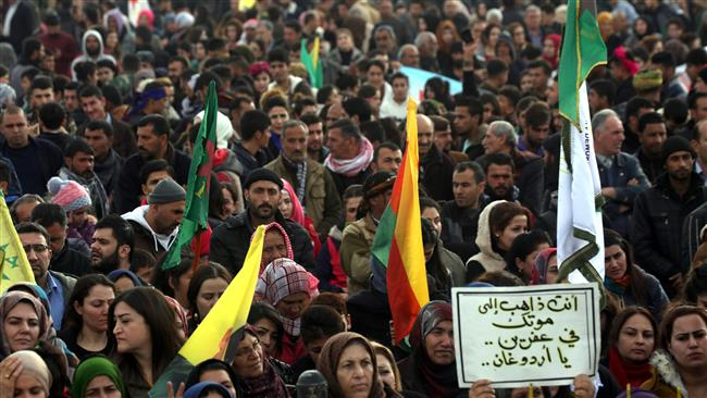 Syrian-Kurds take part in a demonstration