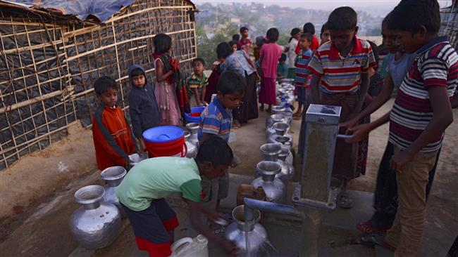 Young Rohingya Muslim refugees collect drinking water at Kutupalong refugee camp in the Bangladeshi district of Ukhia on January 8, 2018.  (Photo by AFP)