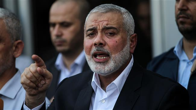 Hamas Chief Ismail Haniyeh speaks to the press on the Palestinian side of the Rafah border crossing in the southern Gaza Strip on September 19, 2017. (AFP photo)