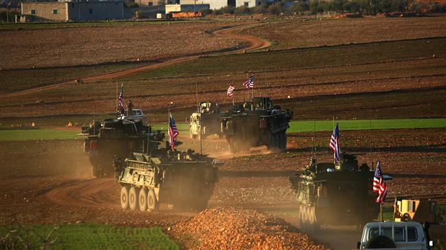 This file photo taken on March 5, 2017 shows a convoy of US armored vehicles driving near the village of Yalanli, on the western outskirts of the northern Syrian city of Manbij. (Photo by AFP)